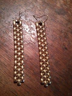 I took a petite ladies gold tone watch and removed the watch to use for something else later, I took the bands and added ear wires to make these long earrings. Cheap yet cool looking.