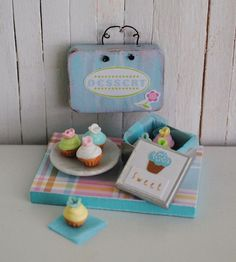 ~ This is an adorable little cupcake assortment that comes with a shabby chic sign that says, Dessert. There is a little tin that is lined