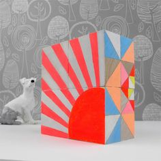 I'm totally into these geometric art blocks from Sketch.Inc on Etsy.