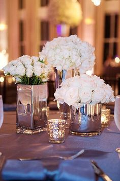 Dripped metal vases are a unique take on mirrored centerpieces.