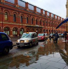 Taxis waiting for travellers at King's Cross railway station. It is a major London railway terminus which opened in 1852 on the northern...