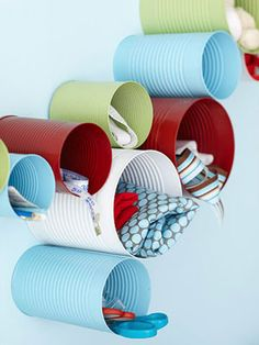 DIY - Old soup cans + spray paint = Wall storage whimsical decoration. What a fun idea, great for a home studio or kids space, or for tight unused closet space. Sewing / crafts/ art would fit perfectly here. Just make sure to get the smells out. Cheap Home Office, Home Office Storage, Home Organization, Organization Quotes, Wall Storage, Craft Storage, Storage Ideas, Recycling Storage, Storage Solutions