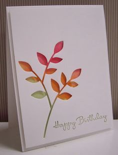 """By Loll Thompson. Mist watercolor paper with lots of water then use a waterbrush to add three colors of re-inkers.  Adhere the watercolored paper to card base. Die cut Poppy Stamps """"Lorelei Outline Lead"""" from white cardstock panel; pop up onto card."""