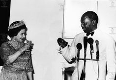 AFRICA, KENYA - Queen Elizabeth II raises her glass to toast with former Kenyan President, Daniel Arap Moi. This took place at State House Nairobi in a banquet given to honour the Queen on her visit to Kenya in November 1983.