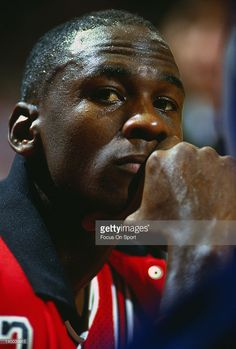 Michael Jordan #23 of the Chicago Bulls looks on from the bench against the Washington Bullets during an NBA basketball game circa 1986 at the Capital Centre in Landover, Maryland. Jordan played for the Bulls from 1984-93 and 1995 - 98.