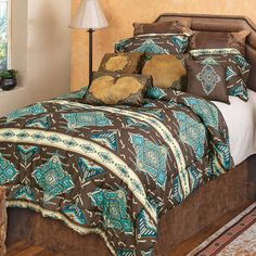 A Lone Star Western Décor Exclusive - Create a southwest feel in your bedroom with this soft microfiber polyester bedding featuring shades of turquoise and mocha in a dazzling diamond pattern with a solid reverse. Sets include comforter, two shams (king has king shams) and one accent pillow. Machine wash.