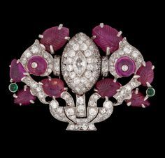 A Cartier Art Deco ruby and diamond brooch, c. 1925-30. Platinum. Brilliant cut diamonds at the back of the brooch.   Copyright @ 2008-2014 Bukowskis Auktioner AB