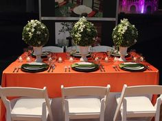 Orange linen, white redin folding chairs, chargers, China and glassware from House of Rental, Skokie, IL
