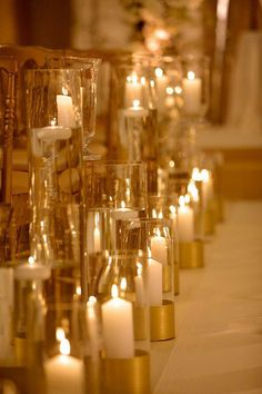 Extravagant Chicago Winter Wedding from Artisan Events - wedding ceremony candle decor idea; Photo: Artisan Events