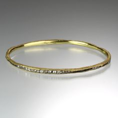 Irregular Channel set bangle by Todd Pownell