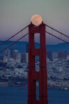 Moon on Golden Gate Bridge. Photo was taken on June 3, 2012 in Sausalito, California