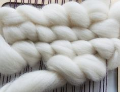 Weaving wool roving in staggered rows
