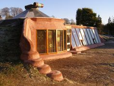 Earthship: completely sustainable home made from recycled materials like bottles, cans and old tires. The first earthship I've ever seen! Natural Building, Green Building, Building A House, Earthship Home, Earthship Design, Earthship Biotecture, Recycling, Vernacular Architecture, Organic Architecture
