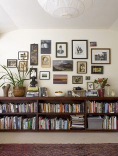 Ingrid Weir art wall and half wall of books
