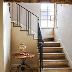 Metal banister and baluster, with nice wood tread and risers.