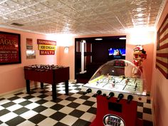 The checkerboard floor, tin ceiling and pink walls in this space conjures up a greasy-spoon diner. A foosball table and air hockey game offer old-fashioned fun for everyone.