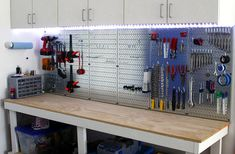 Wall Control's shiny galvanized metal pegboard panels being used here for tool storage above a workbench. This customer added some LED lights under their cabinets to create a cool look and a well-lit work area. Thanks for the great customer submission Gene!