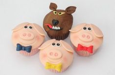 He huffed and he puffed... but this big bad wolf is still surrounded by three little bigs. These fun character toppers will brighten up any party table. Get the recipe: Three little pigs cupcakes