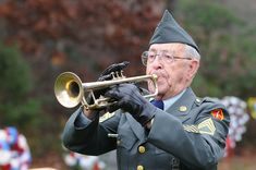 """Albert J. Madden plays """"Taps"""" on his trumpet during a ceremony marking Veterans Day at Massachusetts National Cemetery. (US Air Force photo) Certificate Of Eligibility, Cash Out Refinance, Private Mortgage Insurance, Us Vets, Military News, National Cemetery, Mortgage Payment, Us Air Force, Veterans Day"""