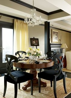 Black chairs... I like it!  Dramatic-formal dining space; Dalia Tamari
