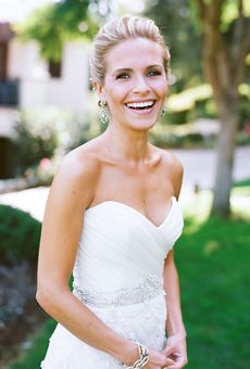 Garden inspired wedding - strapless wedding gown with scallop shaped beaded overlay. Designer Kenneth Pool