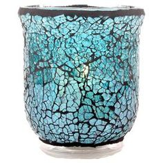 """Glass candleholder with an ocean-hued mosaic motif.   Product: CandleholderConstruction Material: GlassColor: OceanFeatures: Mosaic motifAccommodates: (1) Candle - not includedDimensions: 4.25"""" H x 3.5"""" Diameter"""