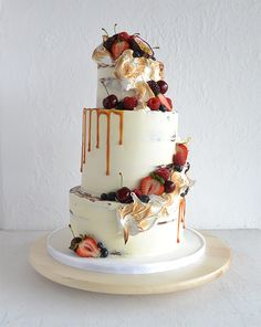 Wedding Cake With Torched Meringue semi naked fruited.