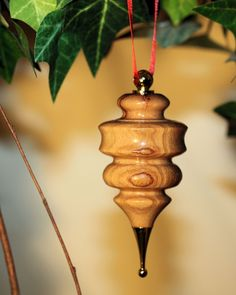 Need a small, inexpensive, custom gift for Christmas?  Maybe for co-workers or your child's teacher?  Hand turned ornaments made from a variety of wood.  This is Olive Wood from Bethlehem.