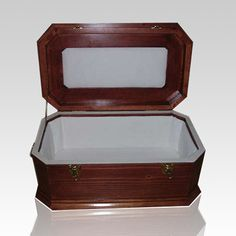 The Cherry Wood Pet Casket with White Lining can be made with three different finishes; cherry, maple, natural and are made from solid pine wood. We have seven inside lining choices; pink satin, blue satin, white satin, white cotton, clouds, cats and dogs.   The exterior wood is perfected and sealed with 3 coats of a durable Gloss Finish.