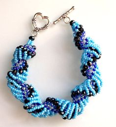 Hey, I found this really awesome Etsy listing at https://www.etsy.com/listing/196345399/dutch-spiral-bracelet-blue-bracelet-wrap