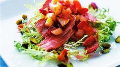 Duck Confit with Frisée, Pistachios, Pear Chutney & Warm Bacon Vinaigrette