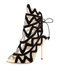 "Mila Suede Cutout Peep-Toe Bootie, Black by Sophia Webster at Neiman Marcus. The heel is 4 1/4""."