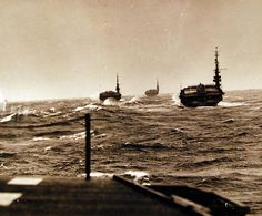 Carrier Division 27 successfully weathering China Sea Typhoon. Taken by USS Salerno Bay (CVE 110). Ships shown are: USS Block Island (CVE 106); USS Gilbert Island (CVE 107); USS Siboney (CVE 112) and USS Salerno Bay (CVE 110). Photographed October 1945. U.S. Navy photograph, now in the collections of the National Archives.