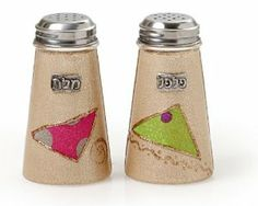 Glass Salt and Pepper Shaker Set with Bright Triangle Design by World of Judaica. $20.00. Material: Glass. Your order includes 1 item(s).. Dimensions: 10cm. You will be pleasantly surprised! The vast majority of our shipments arrive within 10-14 business days from time of shipment, far in advance of Amazon's default calculation of shipping times for items shipped from Israel.. Both practical and elegant, this salt and pepper shaker set will look perfect sitting in the center of...