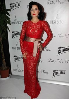Other lady in red: Dita Von Teese dazzled in a lacy red gown at Cointreau & Nikki Beach present Dita Von Teese during the 66th Annual Cannes Film Festival at Boulevard de la Croisette