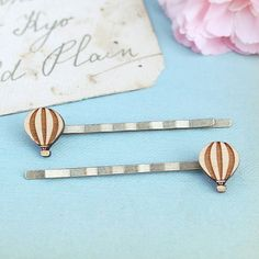 These hot air balloon hair pins. | 24 Wooden Accessories As Unique As You Are