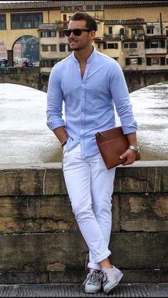 How to wear: light blue long sleeve shirt, white chinos, grey low top sneakers, dark brown leather zip pouch Mens Summer Casual Wear, Men Casual, Outfits Casual, Mode Outfits, Casual Ootd, Street Style Inspiration, White Chinos, White Trousers, Moda Formal
