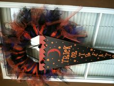 My tulle Halloween wreath. Was easy to make cant wait to start on my thanksgiving and Christmas on. Costs about $15.00 bucks to make. Give it a try!