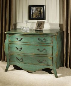 beautiful distressing to this Bombe chest