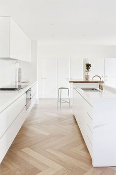 Residence Bright and modern kitchen space with herringbone parquet flooring.Bright and modern kitchen space with herringbone parquet flooring. White Kitchen Cabinets, Kitchen Cabinet Design, Modern Kitchen Design, Minimal Kitchen, Kitchen White, Stylish Kitchen, Modern Cabinets, Kitchen Appliances, Chevron Kitchen