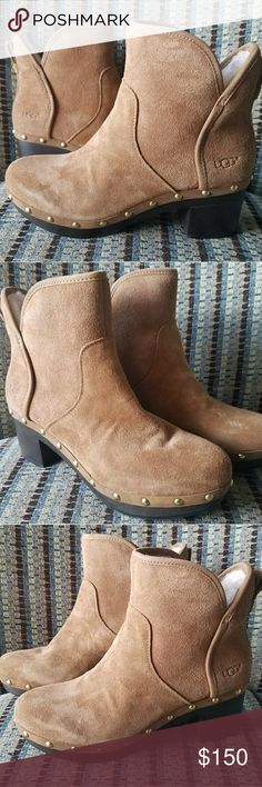 "NWOT UGG Cam II clog boots in chestnut Perfect condition, brand new, never been worn!  The UGG Cam II is a platform bootie with shearing lining. Trimmed with gold rivets, the platform sole gives height and a retro feel, along with a curved topline and plush interior. Round toe and side zip closure. Features a chunky 2.5"" heel and a half inch platform. I no longer have the box, but the left shoe still has the original shaper insert. It's literally never been tried on! 😂 I live in Miami and…"