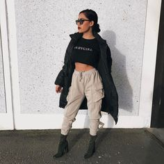 Winter fashion: trench/duster with black croptop, high waisted joggers and skin tight boots
