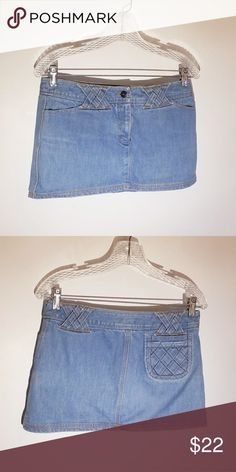 """Milly Miniskirt Adorable light denim skirt with criss-cross detailing on the waistband and back pocket. I absolutely love this item, but it just doesn't fit my style anymore. 2 functional front pockets, and 1 functional back pocket. 11"""" long. Milly Skirts Mini"""