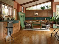 Hickory hardwood floors lend classic beauty and warmth in the kitchen. A favorite of many homeowners, the surface lasts for years and ages gracefully. Photo courtesy of Armstrong