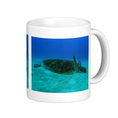 Cool coffee mug featuring a close up view of a Hawksbill Sea Turtle swimming out in the open in the clear blue waters of the Coral Sea on the Great Barrier Reef off the coast of QLD, Australia.