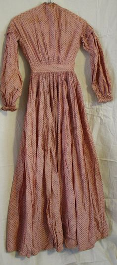 """RARE Antique Victorian c. 1860 Ladies Calico Cotton Day/Work Dress; red calico print, shirring at top of sleeves; front hook & eye closure; flat measures: armpit to armpit: 17""""; waist: 12""""; length: 58.5"""""""
