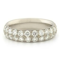 Perfect proportions and stunning materials come together to form an utterly timeless pave band. 32 x 0.05ct diamonds are pavé set across the top 2/3 of the band. TCW 1.60cts.