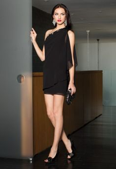 Chiffon one shoulder dress with beaded trim.