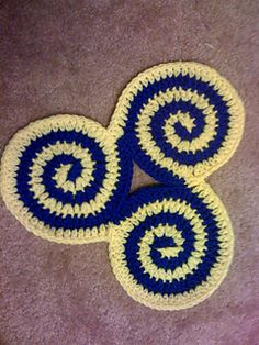 This pattern is available for free. This triple spiral pattern makes a great trivet or potholder when worked in cotton and a lovely decoration with any fiber.