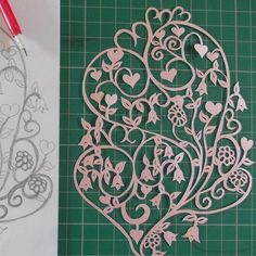 Original, hand drawn, folk style heart papercut by Nina Byers